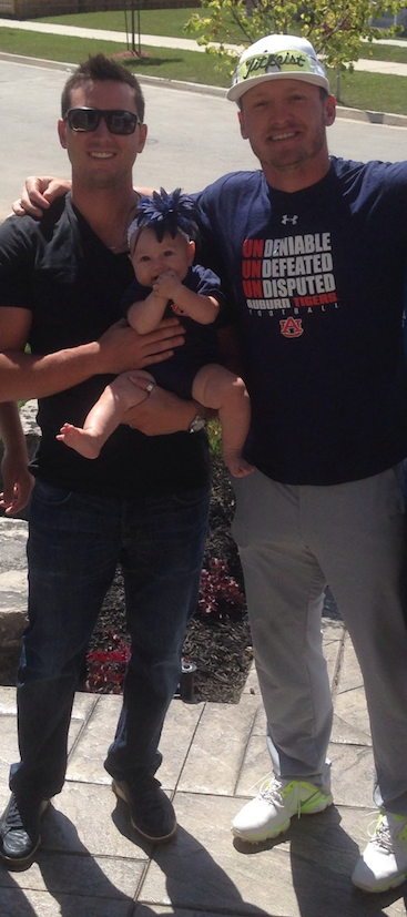Tyler Johnstone (Mississauga, Ont.) his daughter Chole and his former Auburn Tigers teammate Josh Donaldson.