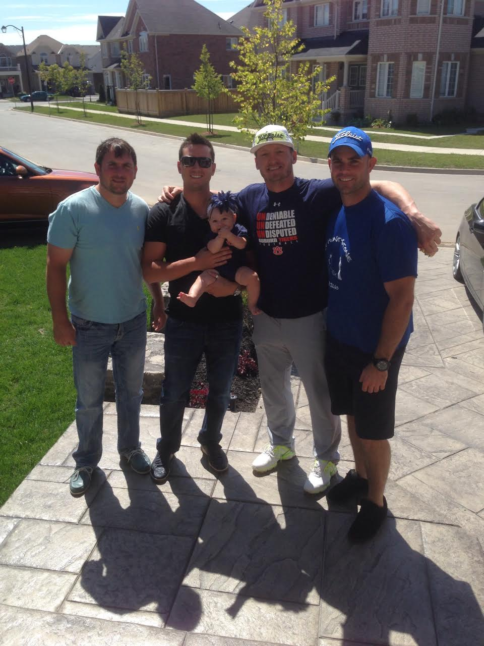 When the Oakland A's came to Toronto in 2013 and had an off day it was time for golf and 2-on-2 hoops game at Tyler Johnstone's place in Milton, From left to right Ryan Dallas, who played together with Johnstone at Purdue, Johnstone and his daughter Chole, Josh Donaldson and Jeff Roglic a former teammate of Johnstone's with the Ontario Blue Jays.