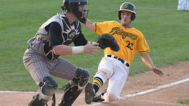 Travis Wacker (Oakville, Ont.) playing summer ball with the Willmar Stingers slides home ...