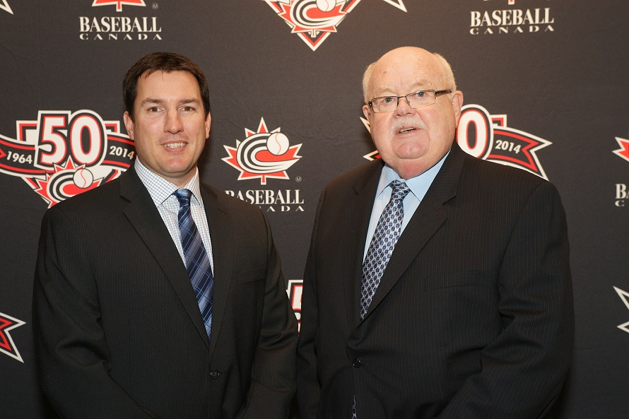Jason Dickson, left, moves into some large shoes taking over for Baseball Canada president Ray Carter.