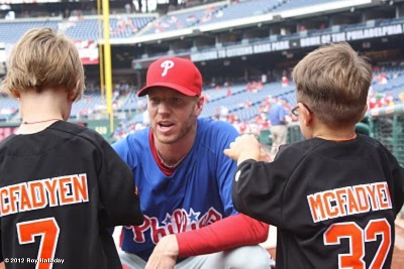 Roy Halladay greets his pals Isaac McFadyen (left) and his brother Gabriel to talk about his Blue Jays days when the Blue Jays visited Philadelphia.