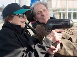 Wayne Norton checks the gun reading as he and his wife Trudy double-team a UBC game last spring. Photo: Wilson Wong.