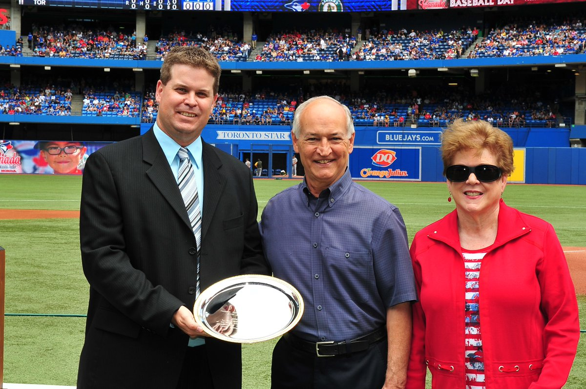 Jerry Howarth is presented with the 2012 Jack Graney Award by Canadian Baseball Hall of Fame director of operations Scott Crawford at Rogers Centre. Howarth's wife Mary was also on hand for the presentation. Photo Credit: Canadian Baseball Hall of Fame