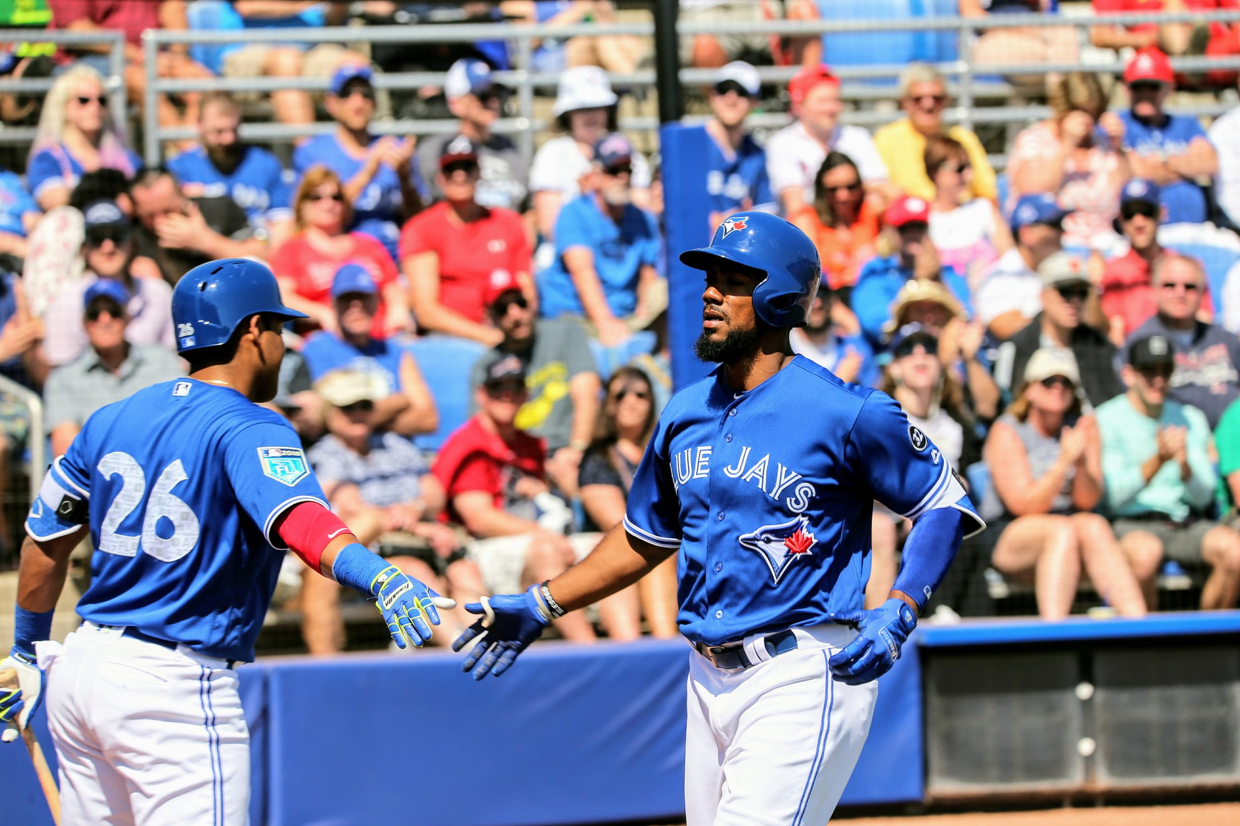 Teoscar Hernandez (right) receives congratulations from Yangervis Solarte after his solo home run in the bottom of the third inning.