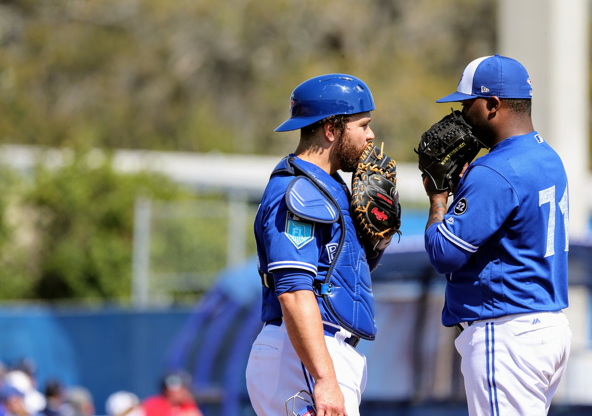 Martin confers with reliever Luis Santos in the fourth inning.