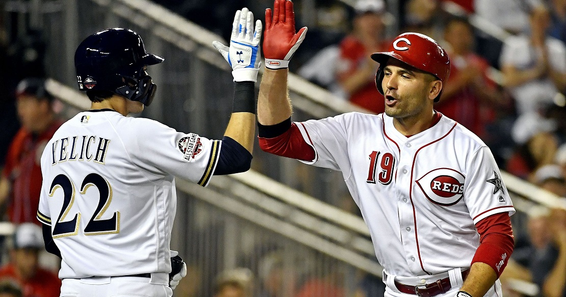 Former Etobicoke Ranger Joey Votto (Etobicoke, Ont.) crosses home plate after hitting the first ever home run by a Canadian in an All-Star game. He crossed the plate to accept congrats from Milwaukee Brewers' Christian Yelich.