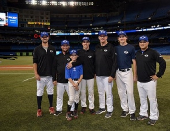 The Rogers Centre was not re-named the Spoljaric Centre … it only seemed that way during Tournament 12 in 2014. Futures Navy coach Chris Begg (from left to right), former workhorse for Team Canada, coach Stubby Clapp, Prime Minister of Canadian baseball on the international stage; Turner Spoljaric, Garner Spoljaric, pappa Paul Spoljaric, former Jays reliever, Hunter Spoljaric, 16, and Hyung Cho, former Seattle Mariners farmhand. (Photo Credit: Alexis Brudnicki).