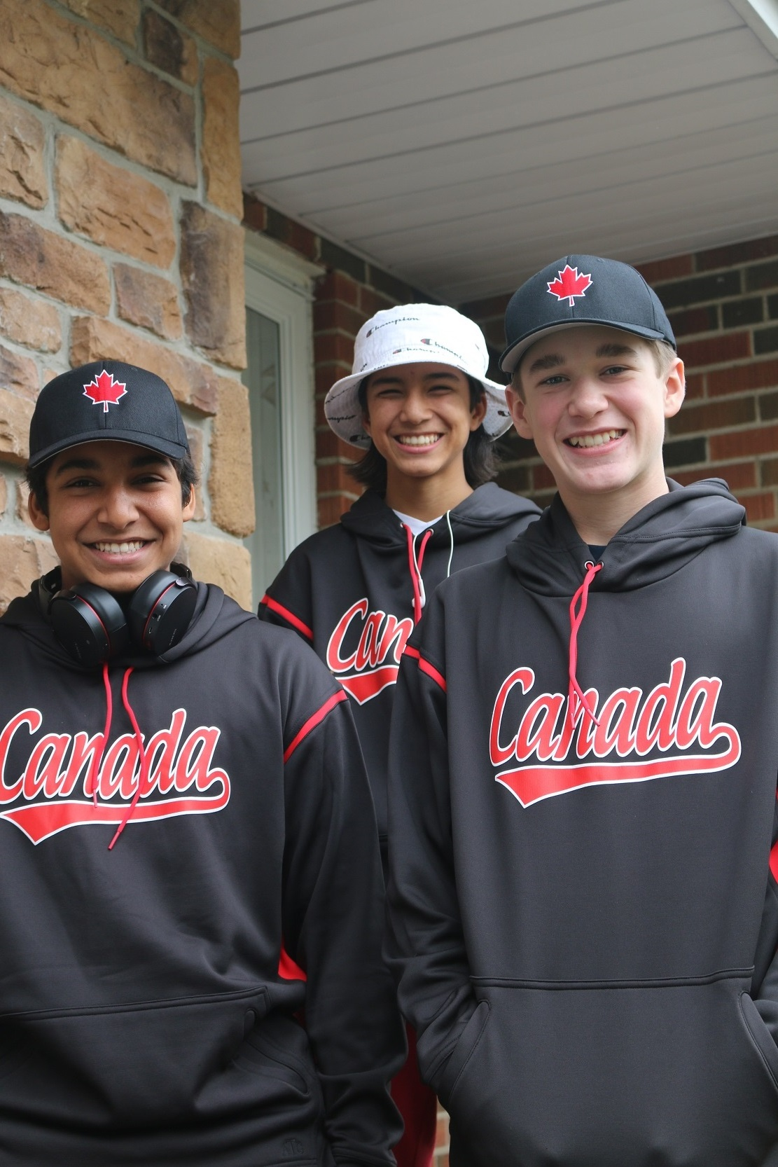 Pals Dominic Lora, left, Keiran Martini-Wong and Lachlan Maude before heading south. Obviously one player removed his hat from Gilligan's Island when the games began. Photo: Saskia Martini-Wong Studios.