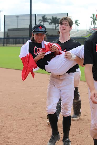 Eric Rutherford carries Keiran Martini-Wong off the field. Photo: Saskia Martini-Wong Studios.