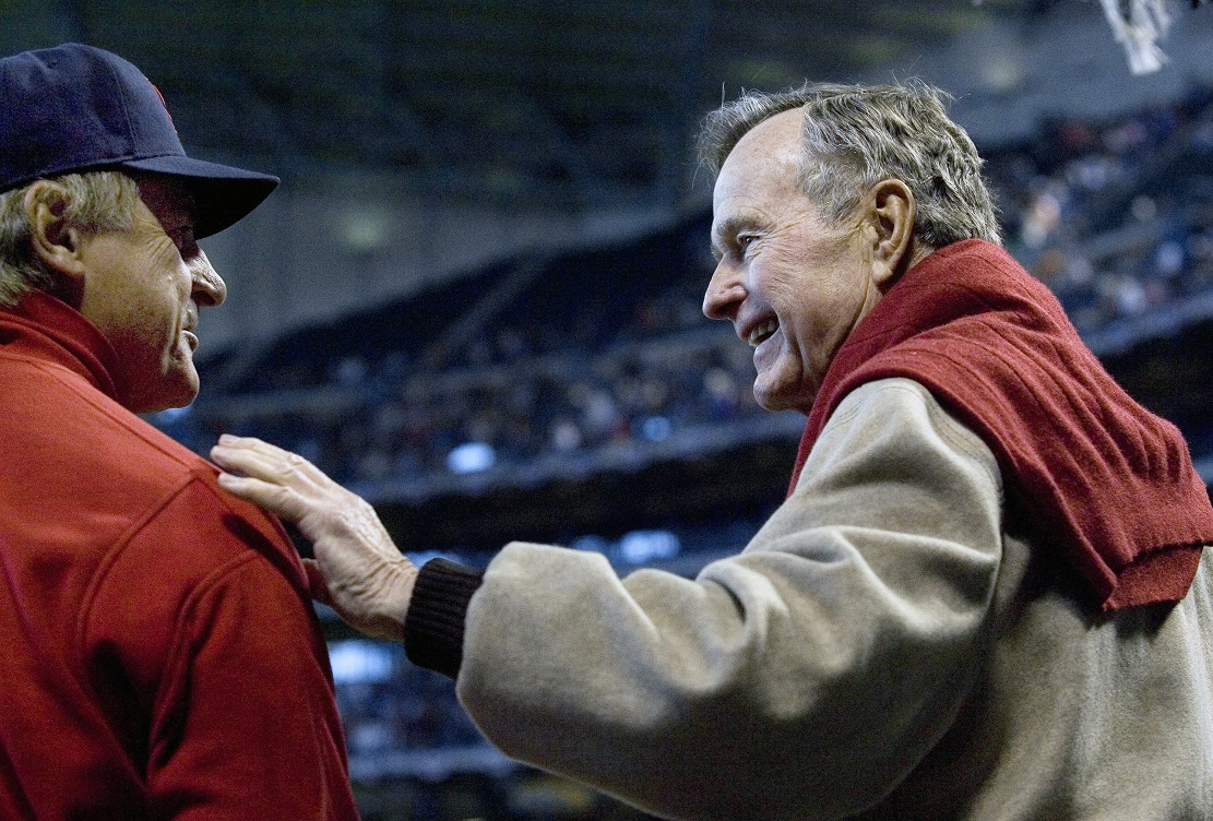 President George H. W. Bush, right, talks with St. Louis Cardinals manager Tony La Russa prior to the start of a Houston Astros game in 2007, at Houston. Photo: Dave Einsel/AP.