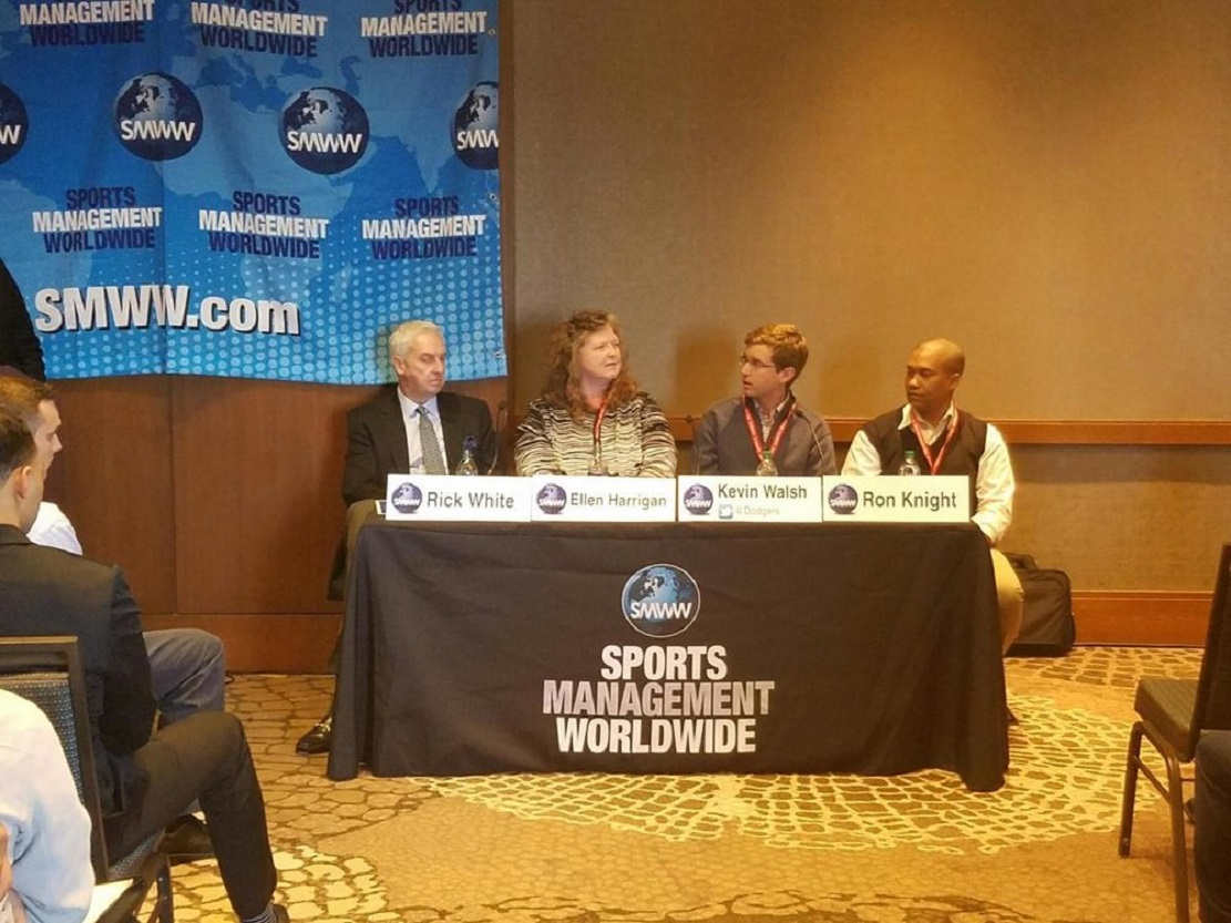 Ellen Harrigan, second from left with RICK WHITE, ATLANTIC LEAGUE PRESIDENT, KEVIN WALSH, DODGERS COORDINATOR OF VIDEO OPERATIONS AND RON KNIGHT, ATLANTA BRAVES MINOR LEAGUE ADMINISTRATION AT SPORTS MANAGEMENT WORLDWIDE CONFERENCE.