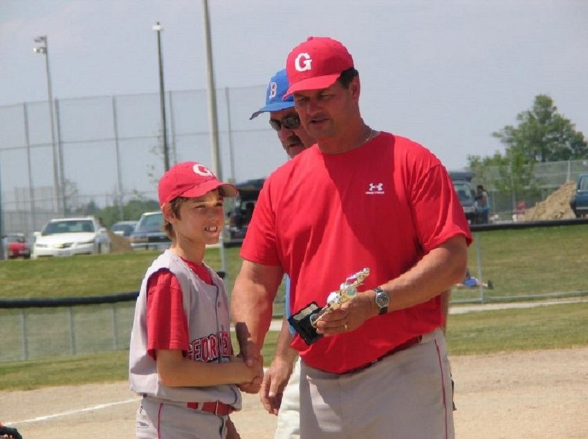 Cincinnati Reds scout Billl Byckowski (Georgetown, Ont.) presenting a trophy to his Georgetown Eagles CF Mark Jankowski in 2007 after a Brampton tourney. Byckowski is the Canadian Baseball Network 2018 Scout of the year and winner of the Jim Ridley award. Jankowski grew up to be a first-round pick of the Calgary Flames.