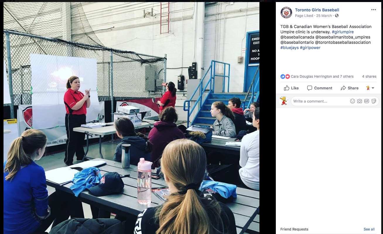 Lisa Turbitt is shown here presenting at an umpire's clinic for the Toronto Girls Baseball League.