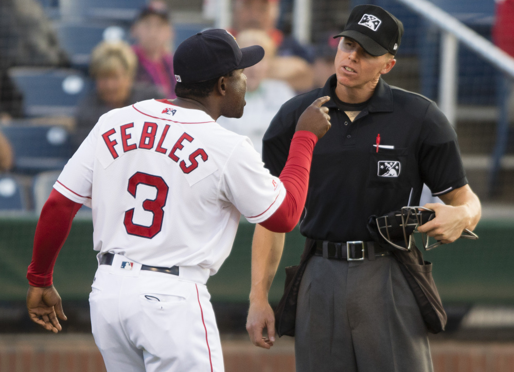 Canadian umpire Chris Graham (Brampton, Ont.) entertains an argument from double-A Portland Sea Dogs manager Carlos Feebles on June 24, 2016. Photo Credit: D. Walsh, Portland Press Herald