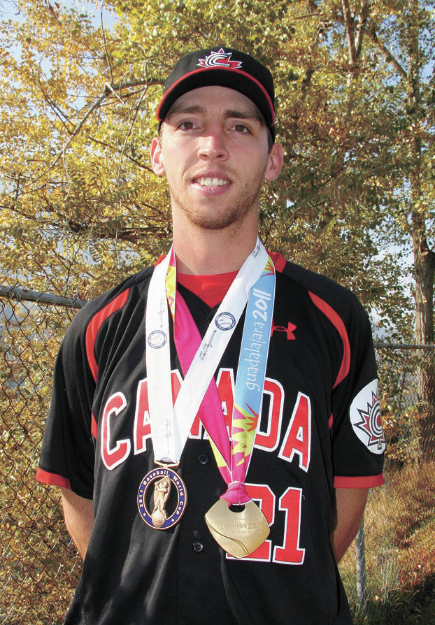 Former Team Canada pitcher Chris Kissock (Trail, B.C.) is shown here with his gold and bronze medals from the 2011 Pan Am Games and World Cup. Photo: Trail Times