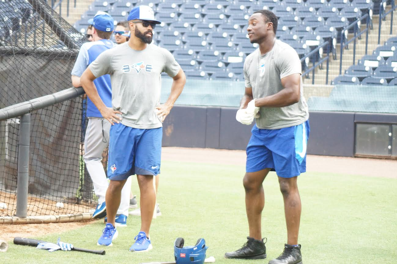 Oakville Royals' grad OF Dalton Pompey (Mississauga, Ont.), left, begins his rehab assignment Monday with the class-A Dunedin Blue Jays. and during batting practice chats with former Ottawa-Nepean Canadians OF Demi Orimoloye (Ottawa, Ont.) in Tampa. Photo: Eddie Michels.