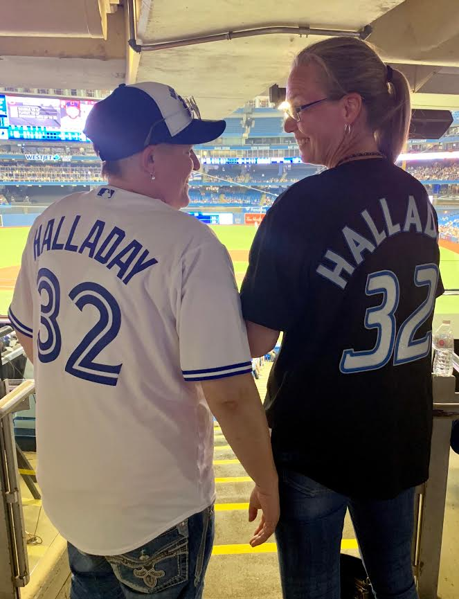 Merinda Halladay, right, sister of the first Blue Jays homegrown Hall of Fame inductee RHP Roy Halladay and her wife Kelly were two of the seven members of the Halladay clan who dropped by the Rogers Centre Monday night.