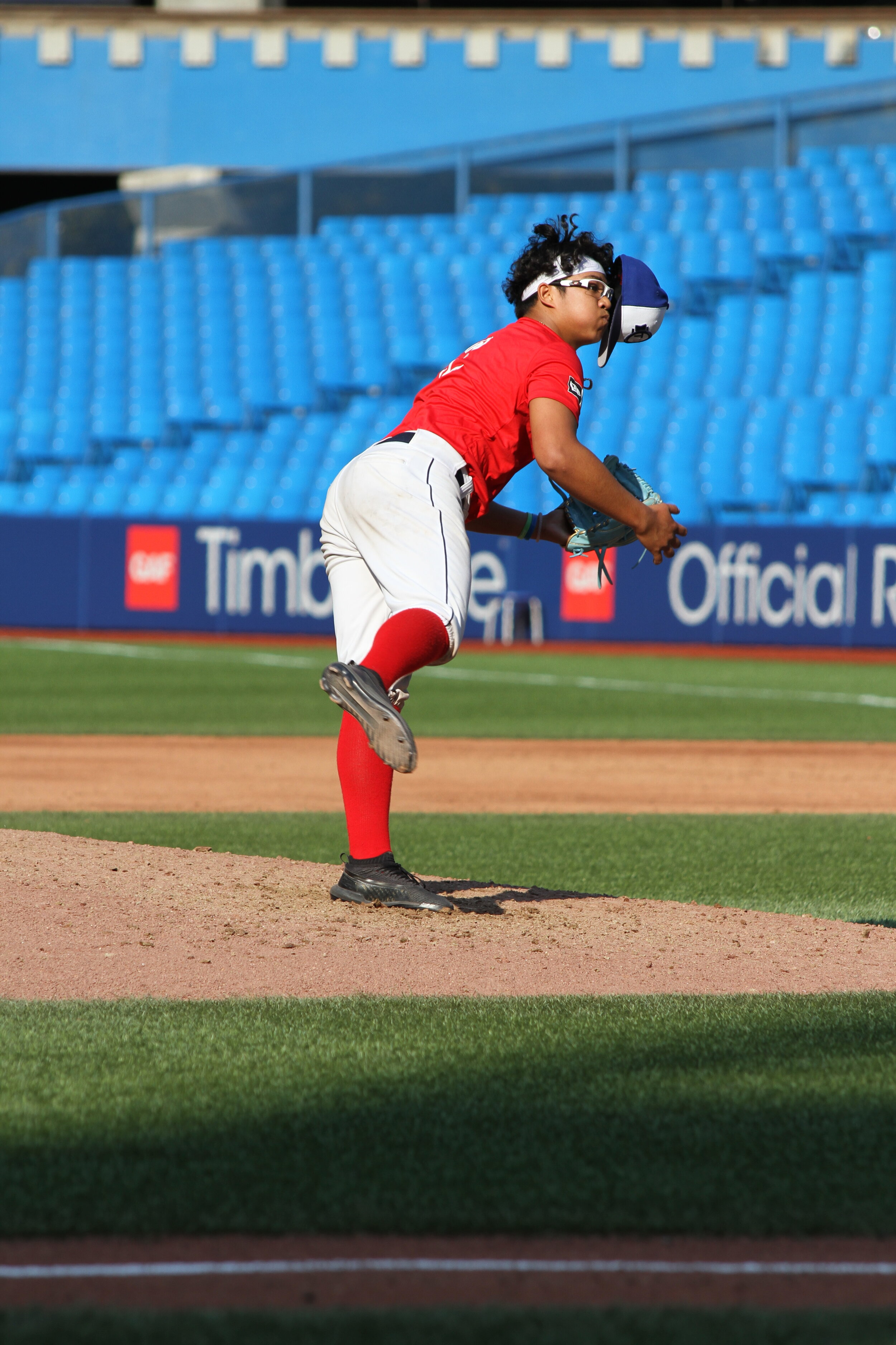 Another of UBC Thunder RHP Vicarte Domingo's skills is still pitching effectively despite his hat falling off, which happened several times in the Tournament 12 Prospects Game on Saturday. Photo: J.P. Antonacci