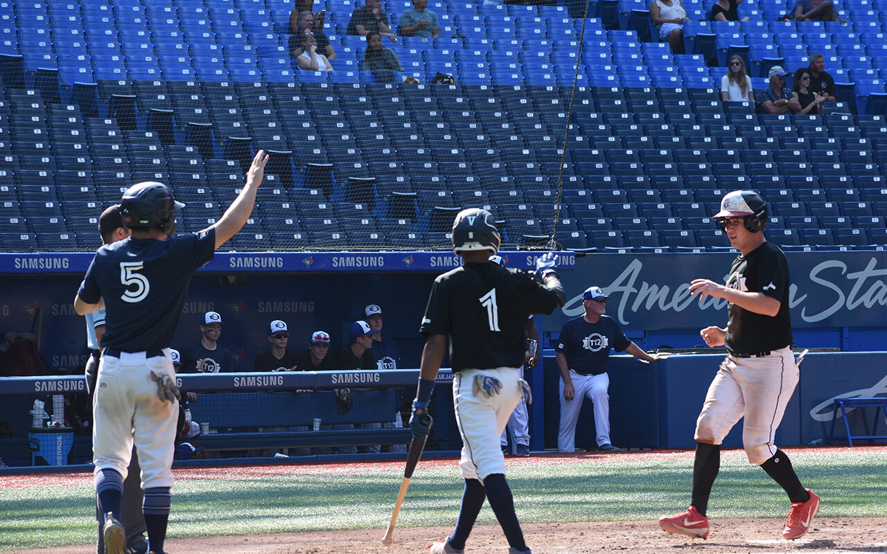 Langley Blaze C/OF Russell Young (Surrey, B.C.) scores the sixth and final run for Team Roberto Alomar to seal a 6-1 victory over Team Sandy Alomar Sr. in the T12 Prospects Game at Rogers Centre on Saturday. Photo: Marcus Rebelo