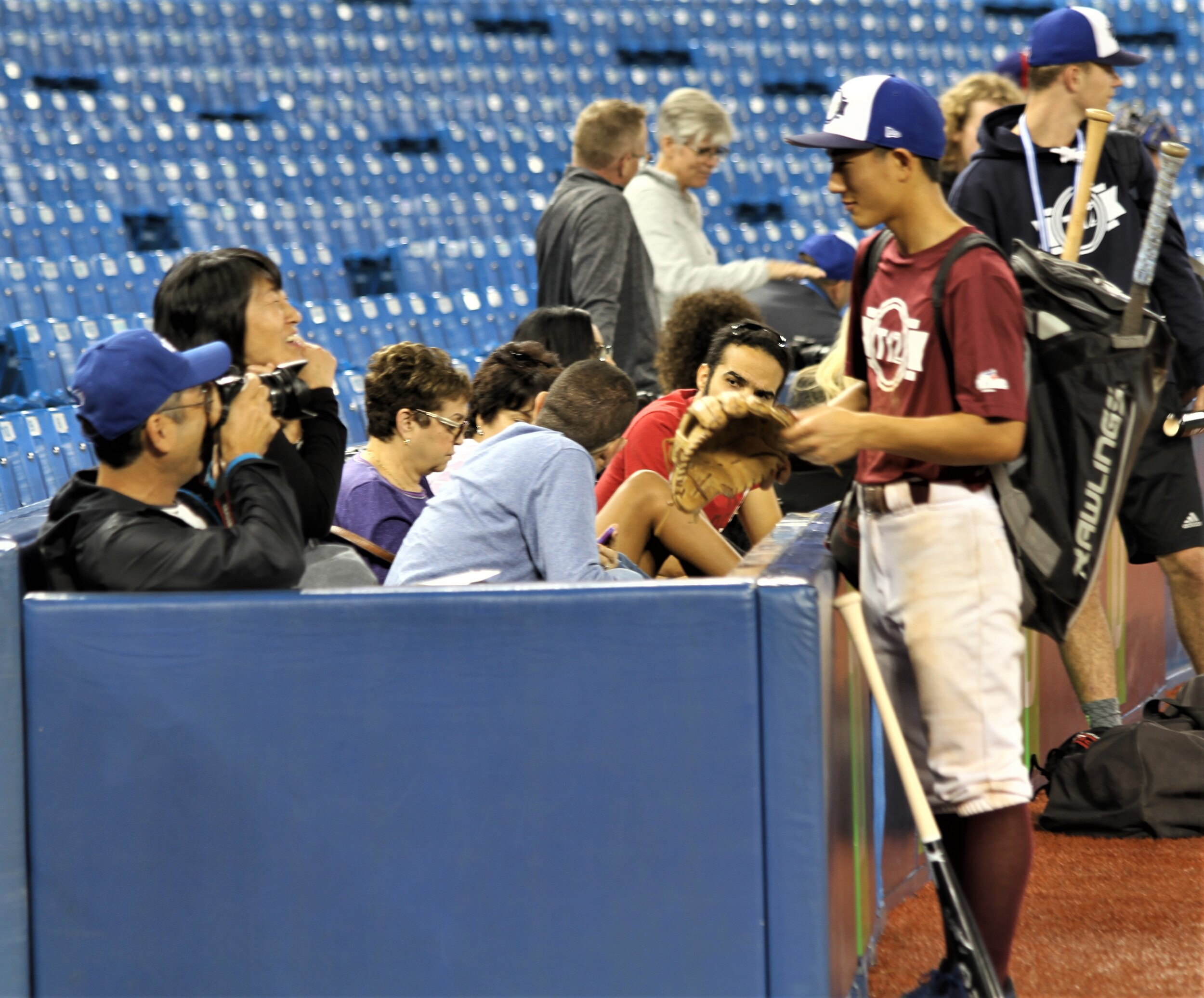Proud parents Yukihiro and Yukiko Fujie greeted their son, Yosuke Fujie (Mission, BC), after Team Maroon beat Team Black 5-1 on Friday at Tournament 12 at Rogers Centre. Yukihiro plays with the Fraser Valley Cardinals. Photo: J.P. Antonacci