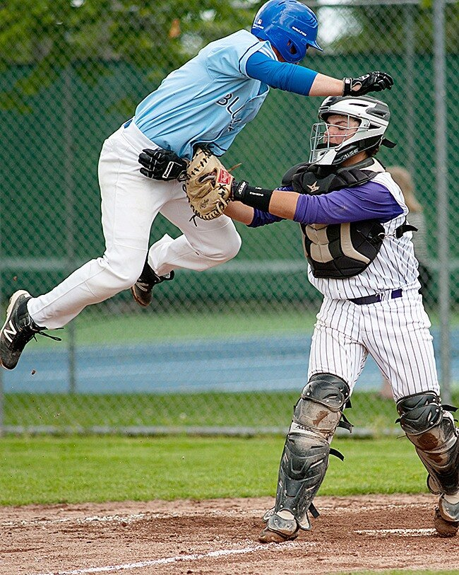 North Delta Blue Jays grad Logan Newman (Delta, BC) arrives at the plate in mid air. He had 25 hits for the Douglas Royals.