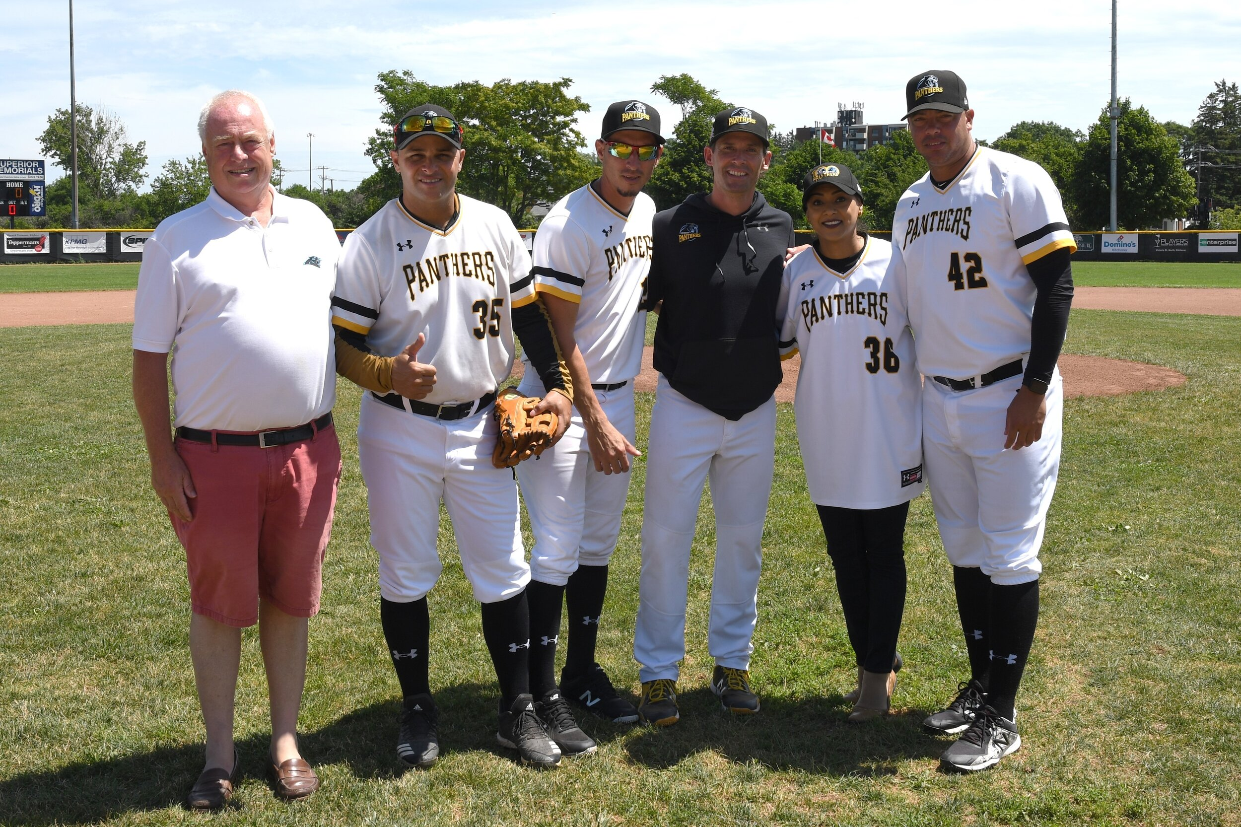 Kitchener Panthers GM Mike Boehmer, left, poses with Kitchener MP Bardish Chagger, second from right, along with Panthers manager Luke Baker and Cuban players Yorbis Borroto (35), Yuen Soccaras in middle, and Miguel Lahera (42). Missing is Yoennis Yera. Photo by Dan Congdon