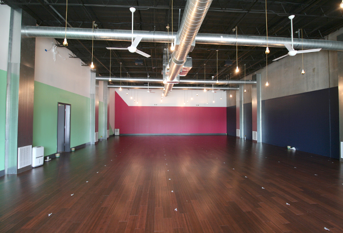 This is where the magic happens! The Community Studio is one of two large studio spaces, and this one can hold 115 mats!