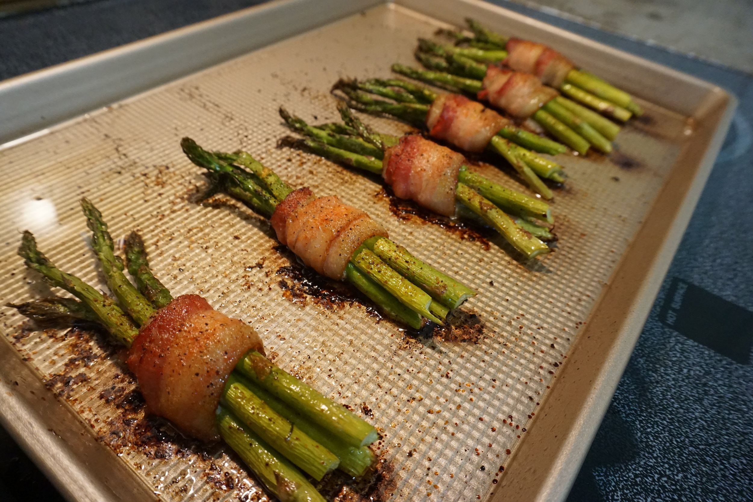 Bacon Wrapped Asparagus - This recipe combines the saltiness from the bacon with the sweet taste of the Everglades Rub that caramelizes when cooking in the over.