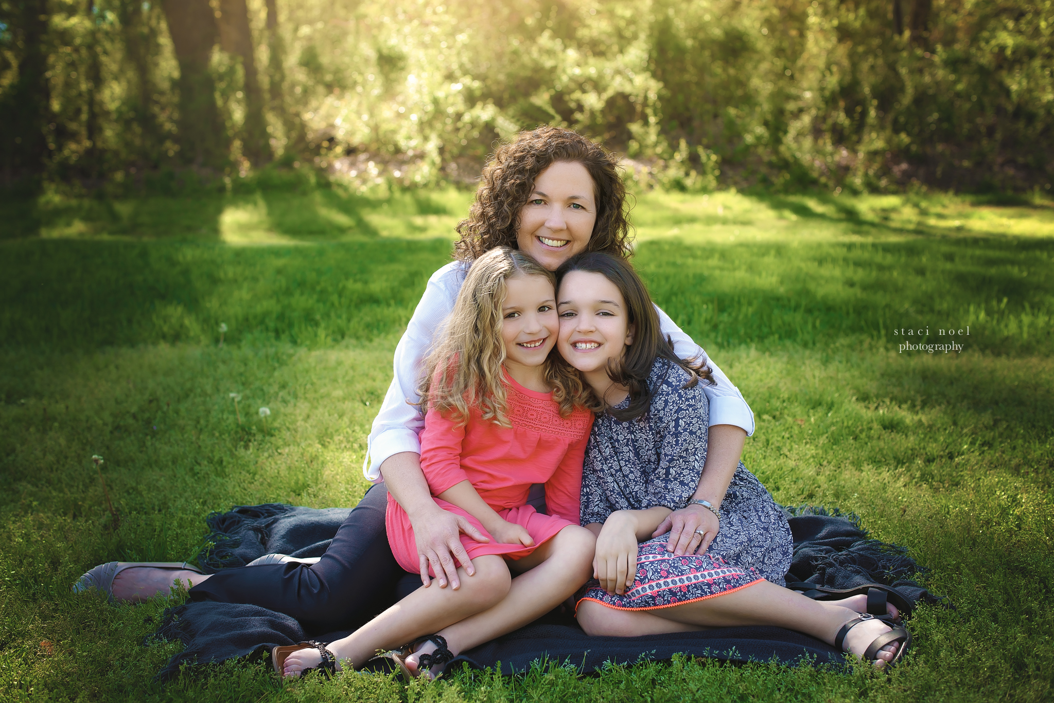 charlotte's best family photographer staci noel photographer captures family images iof mother and daughters in park setting outdoors in natural light