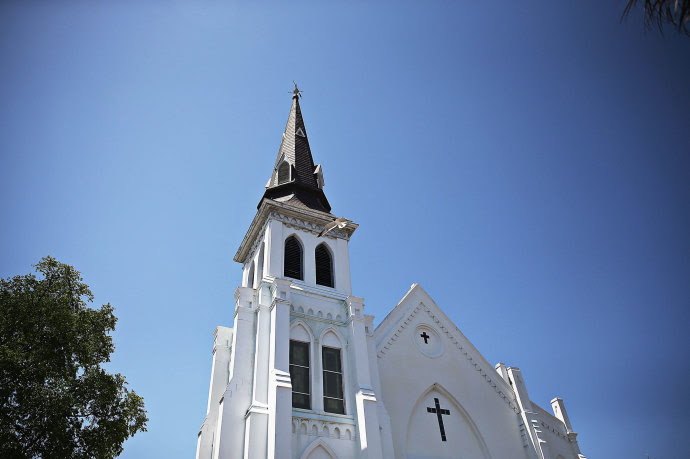 The Emanuel A.M.E. Church in Charleston, South Carolina, a day after Dylann Roof allegedly murdered nine congregants following a Bible study.  REDIT PHOTOGRAPH BY: JOE RAEDLE/GETTY