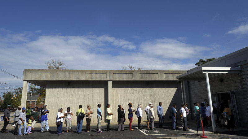 People wait in line to vote at the Board of Elections early voting site on Oct. 18, 2012, in Wilson, N.C. The U.S. Justice Department and several groups are suing North Carolina over the sweeping election overhaul it passed two years ago. Sara D. Davis/Getty Images