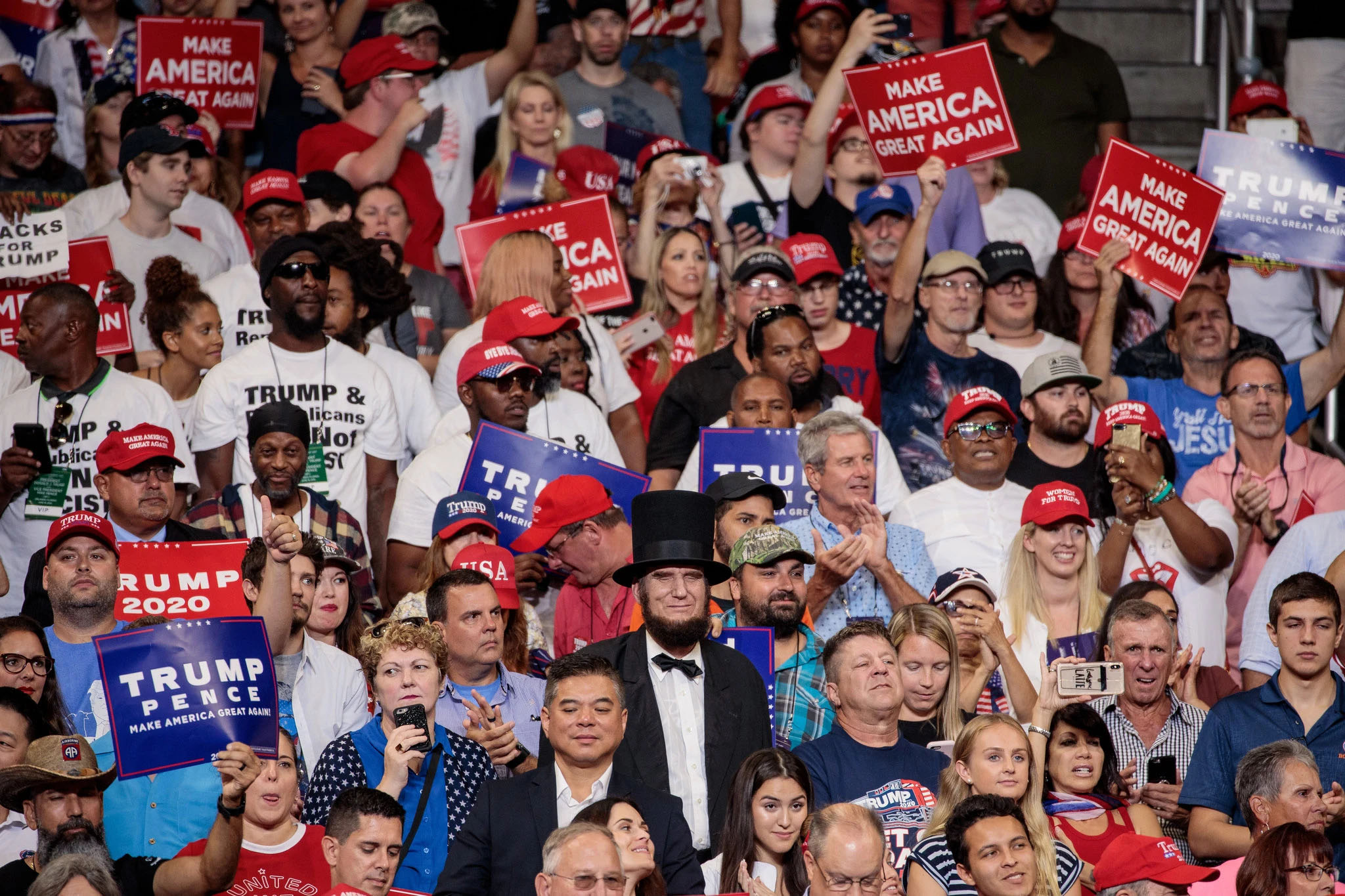 PHOTO CREDIT: A Lincoln impersonator in the crowd at a Trump re-election rally in Orlando, Fla., in June. Damon Winter/The New York Times