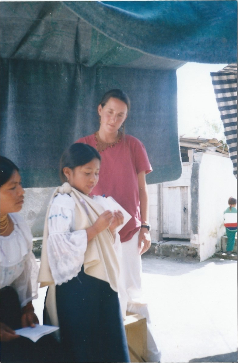Anita leading, reading and translating women's rights from Spanish to Kichwa alongside her mother Rosa Elena to the community.