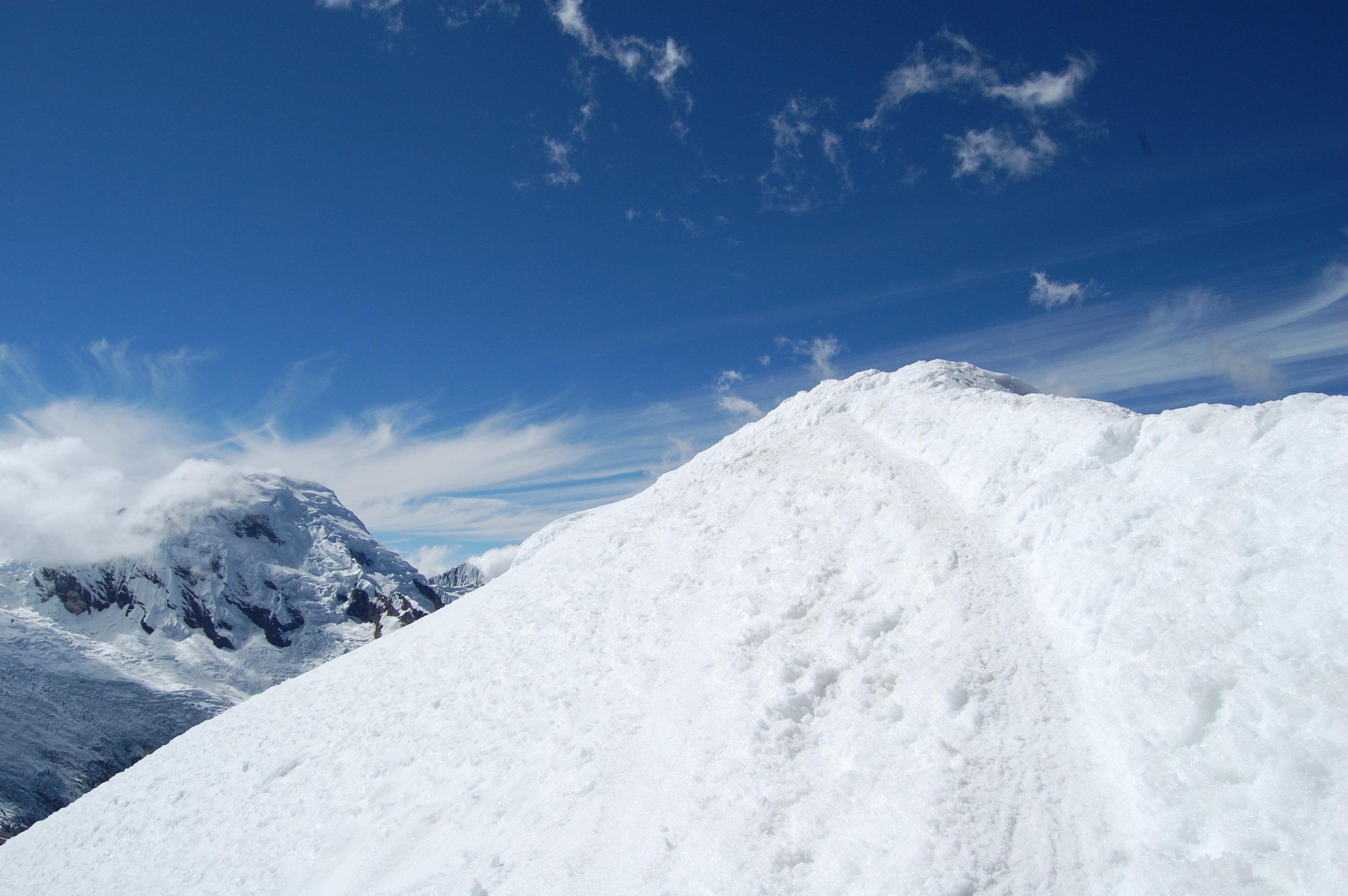 Tiny, steep summit on Ishinca, Cordillera Blanca, Peru