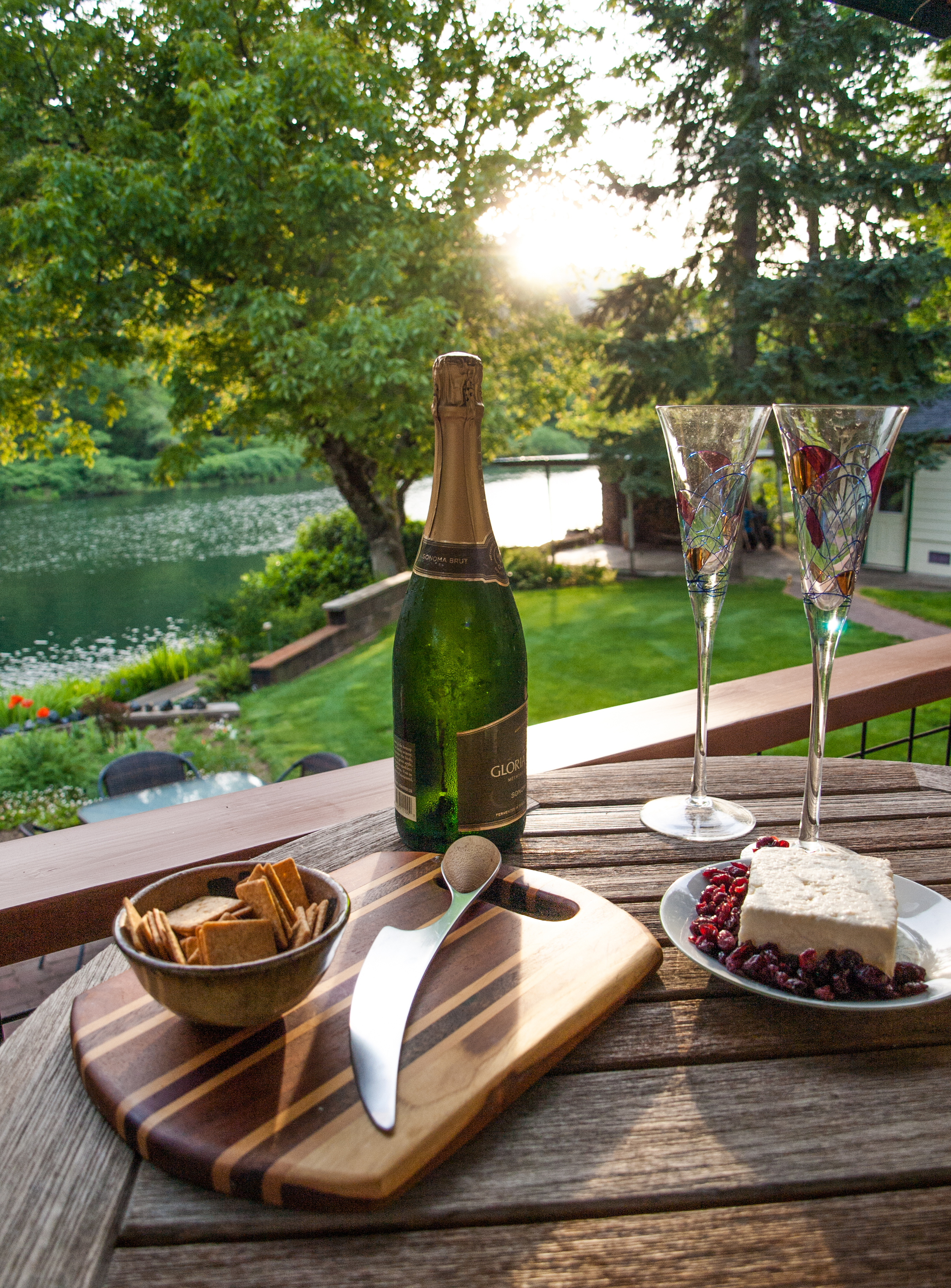 Watch the sun set over the forest and river paired with snacks and a beverage!