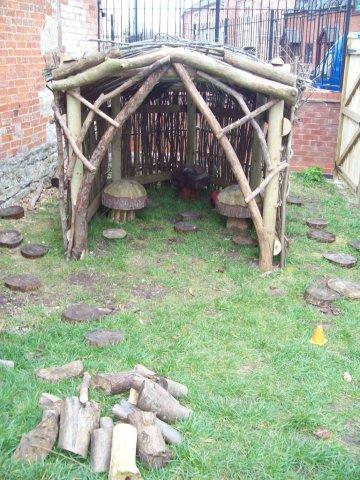 """The Forest Garden  Providing a woodland experience, this area is left as natural as possible, allowing children to """"bake"""" mud pies in the mud kitchen; making dens, pretending to be bears and re-enacting fairy tales."""