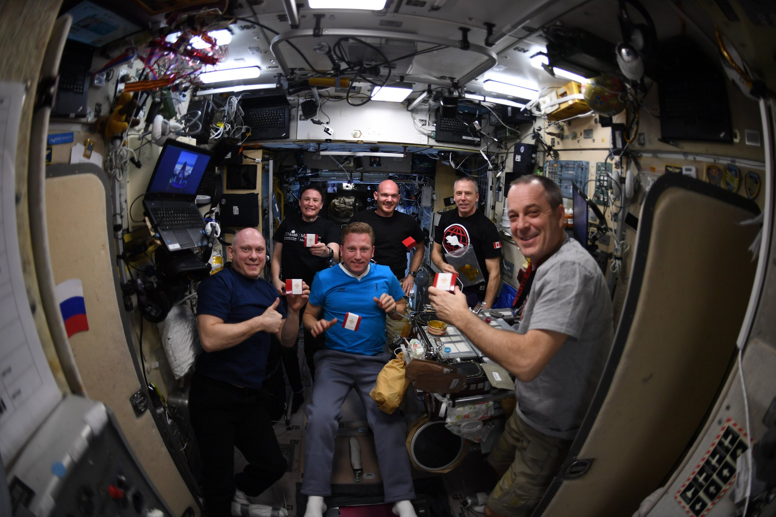Peace By Chocolate on the Space Station  - Astronauts from around the world. coming together, each with a Peace by Chocolate™ box. Image courtesy of CTV News.