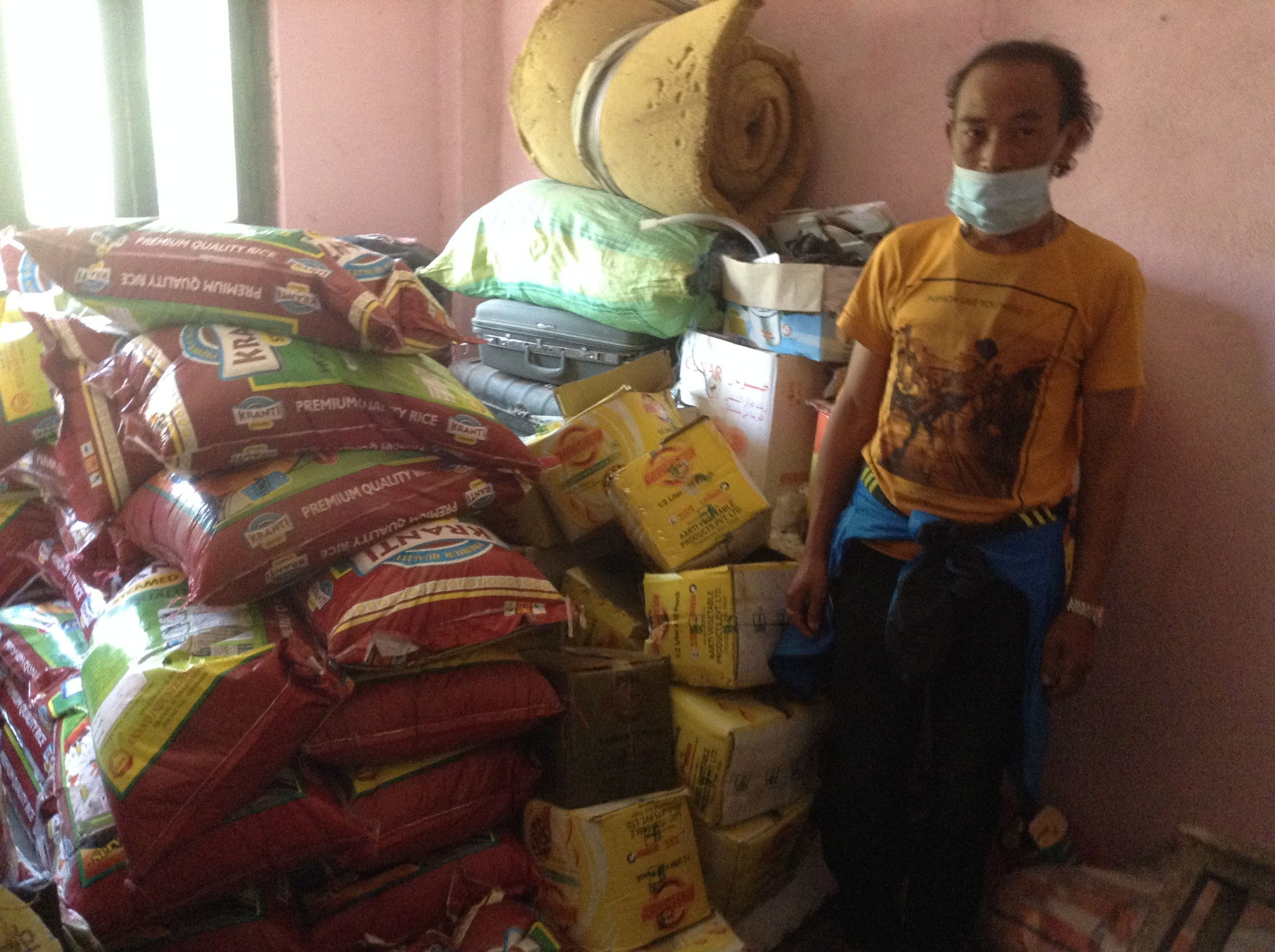 SUman Lama, OUr Sankhu Relief Center Coordinator attending to the supply Depot