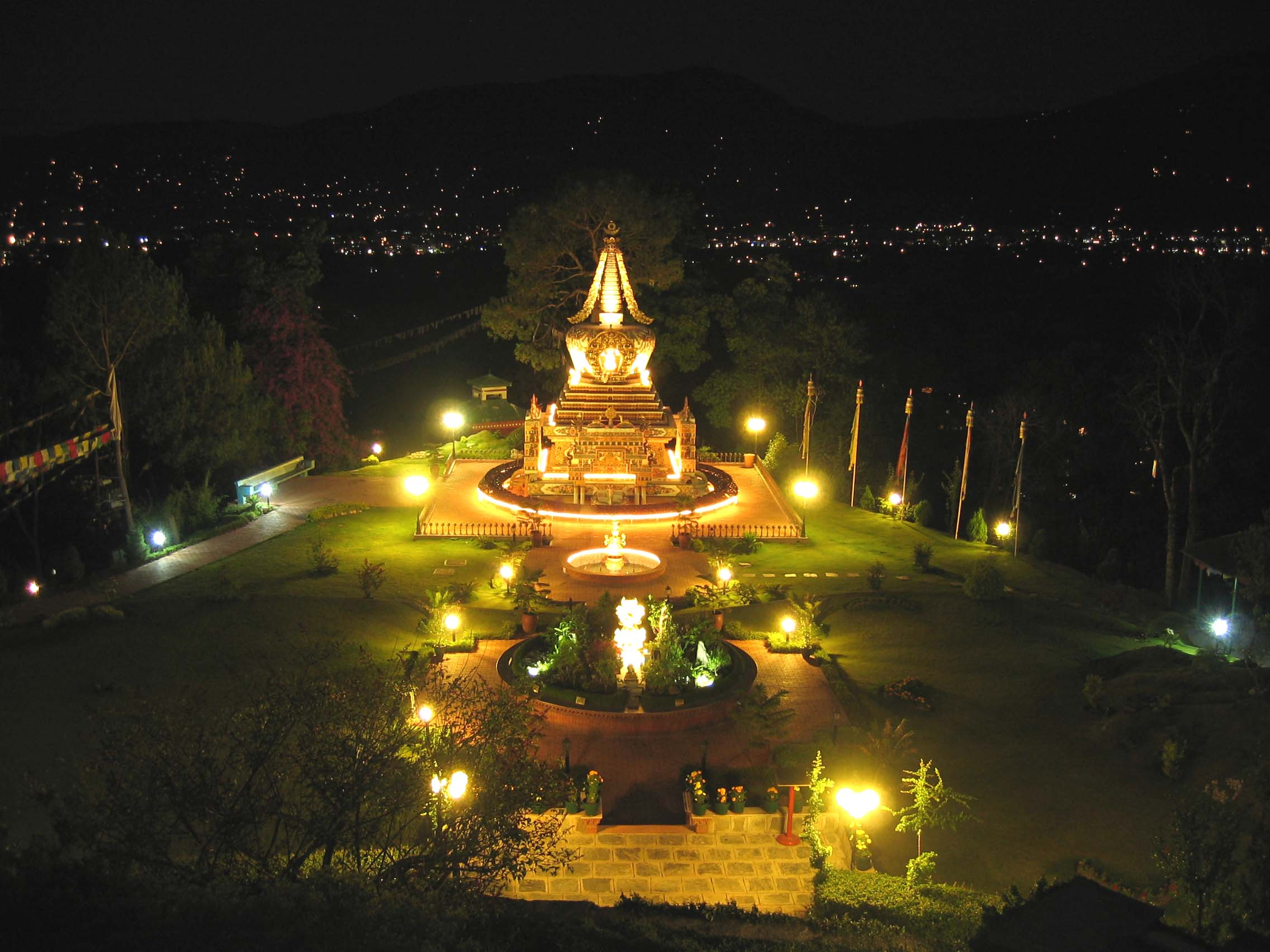 Solar illuminated stupa and gardens at night