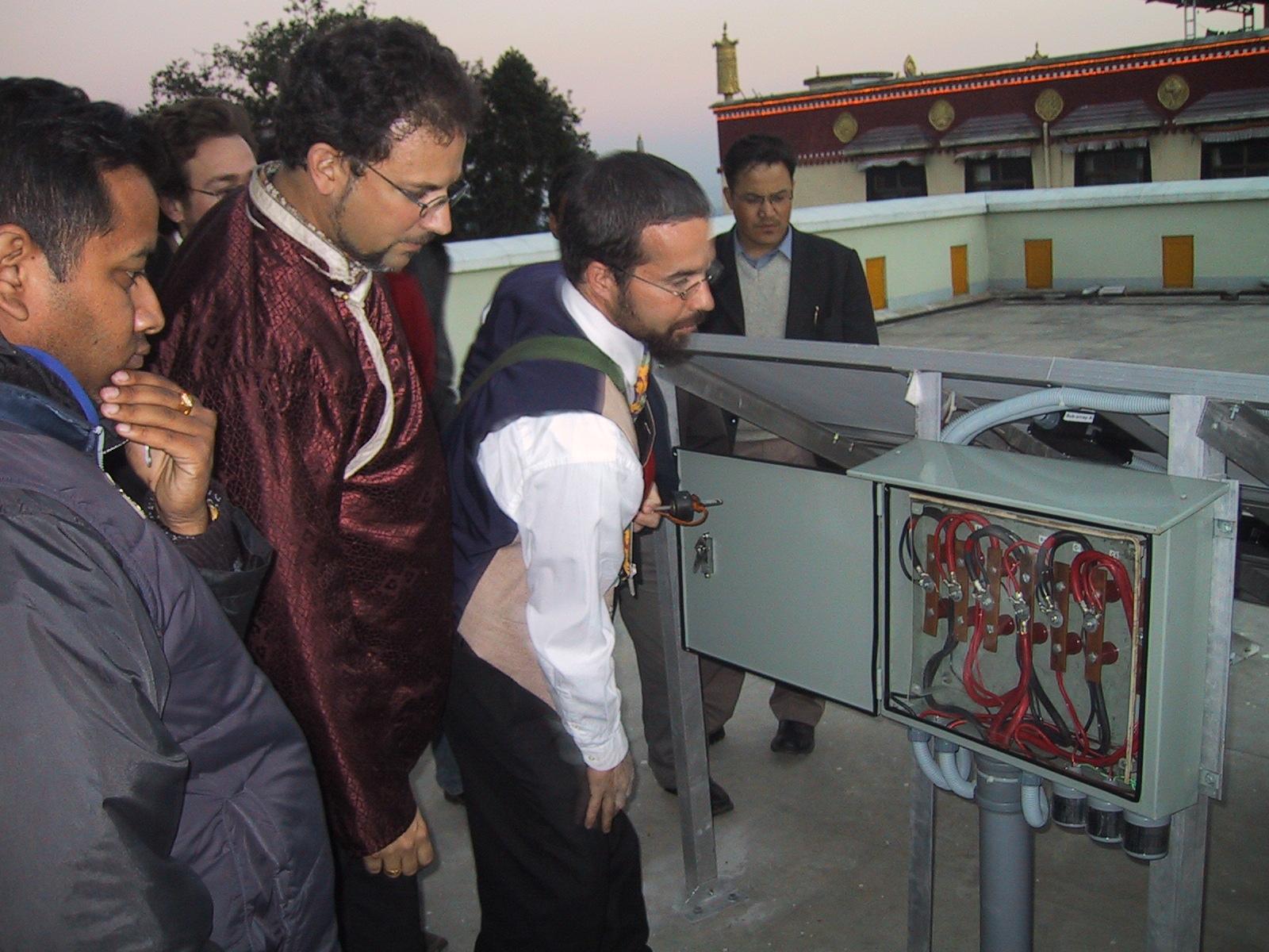 Lama Rangbar inspects the system.JPG