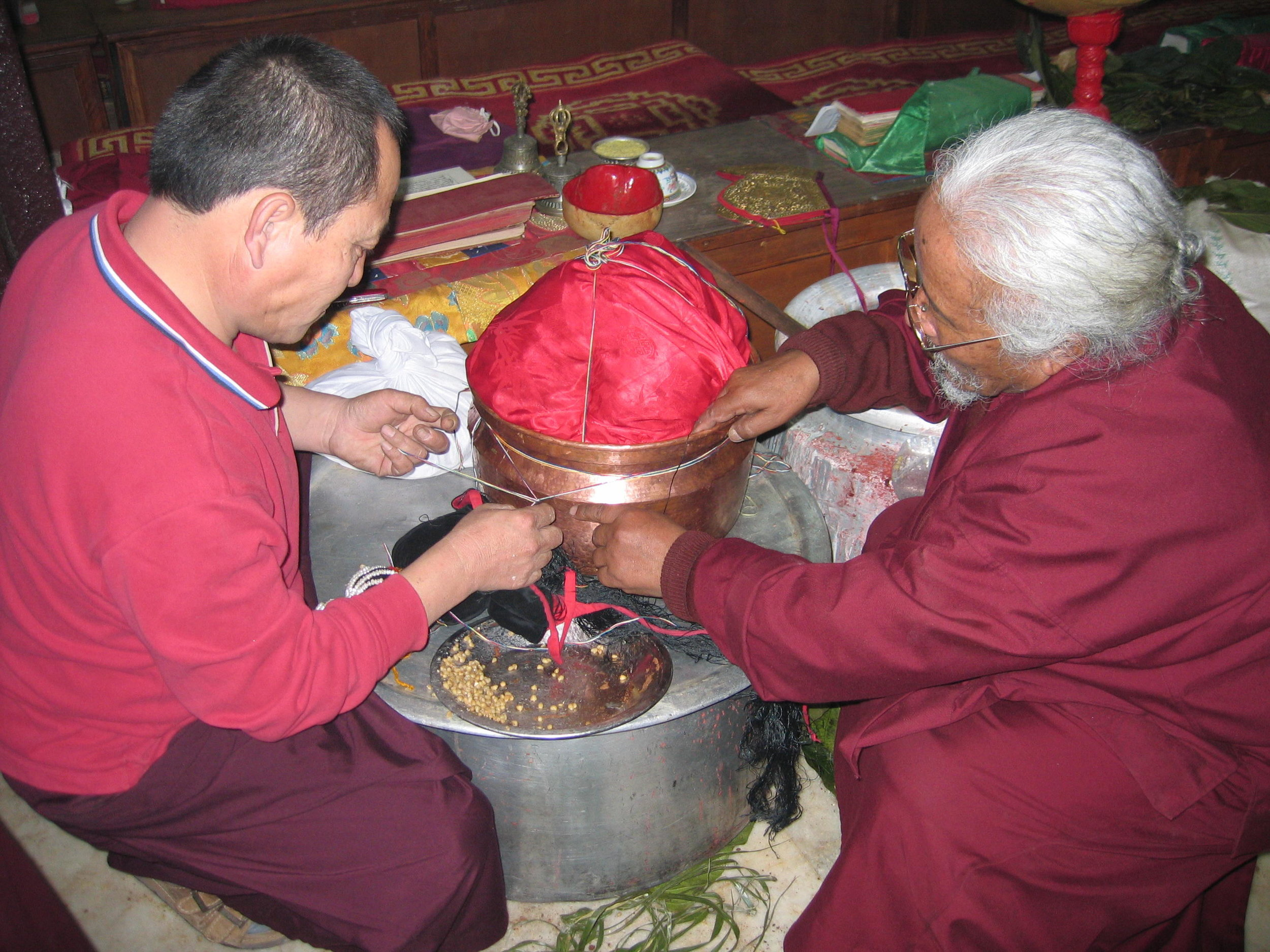Lama Sonam Tobgye prepares Mendrup for the Mandala