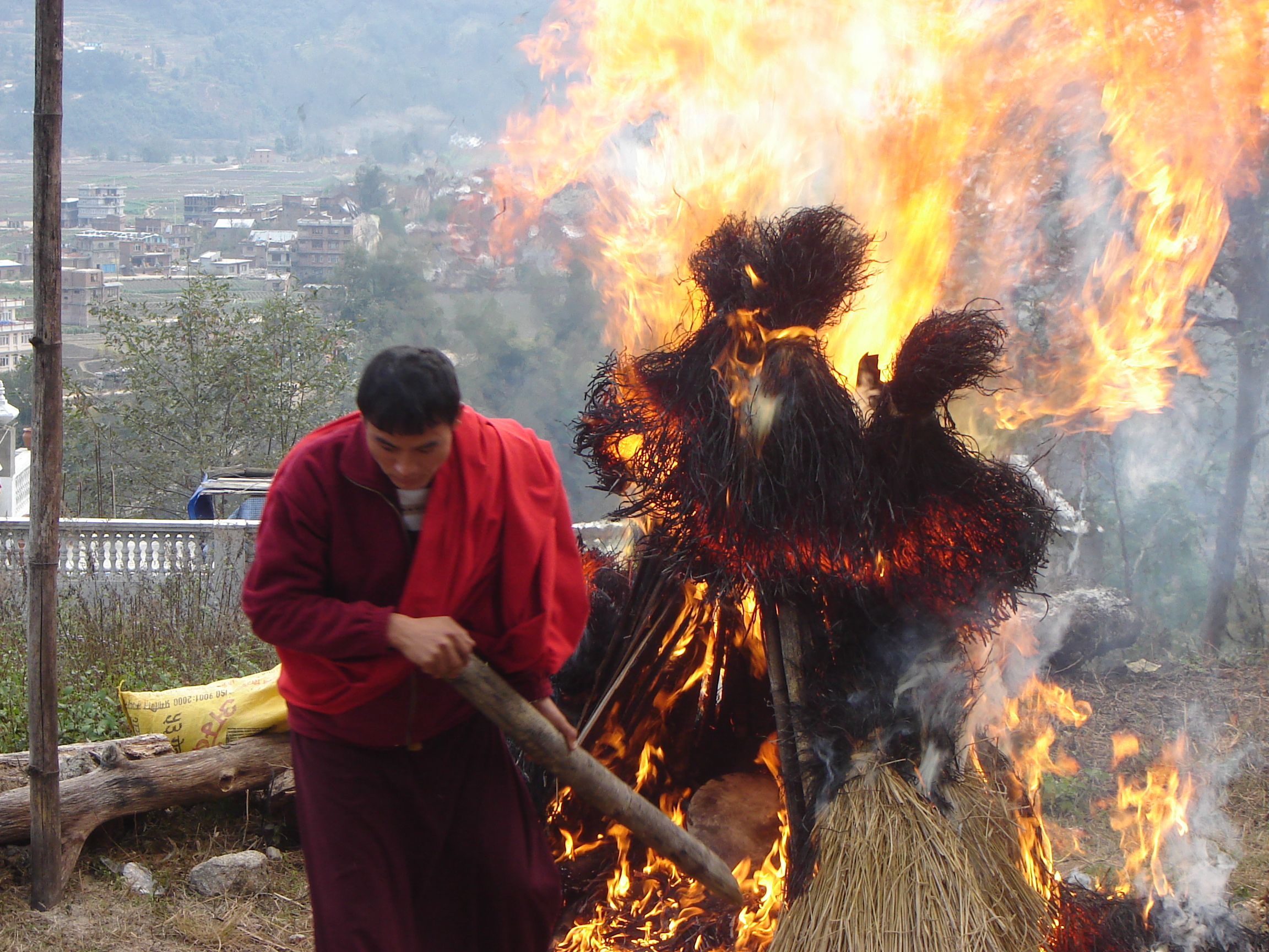 The Torma is cast into the flames