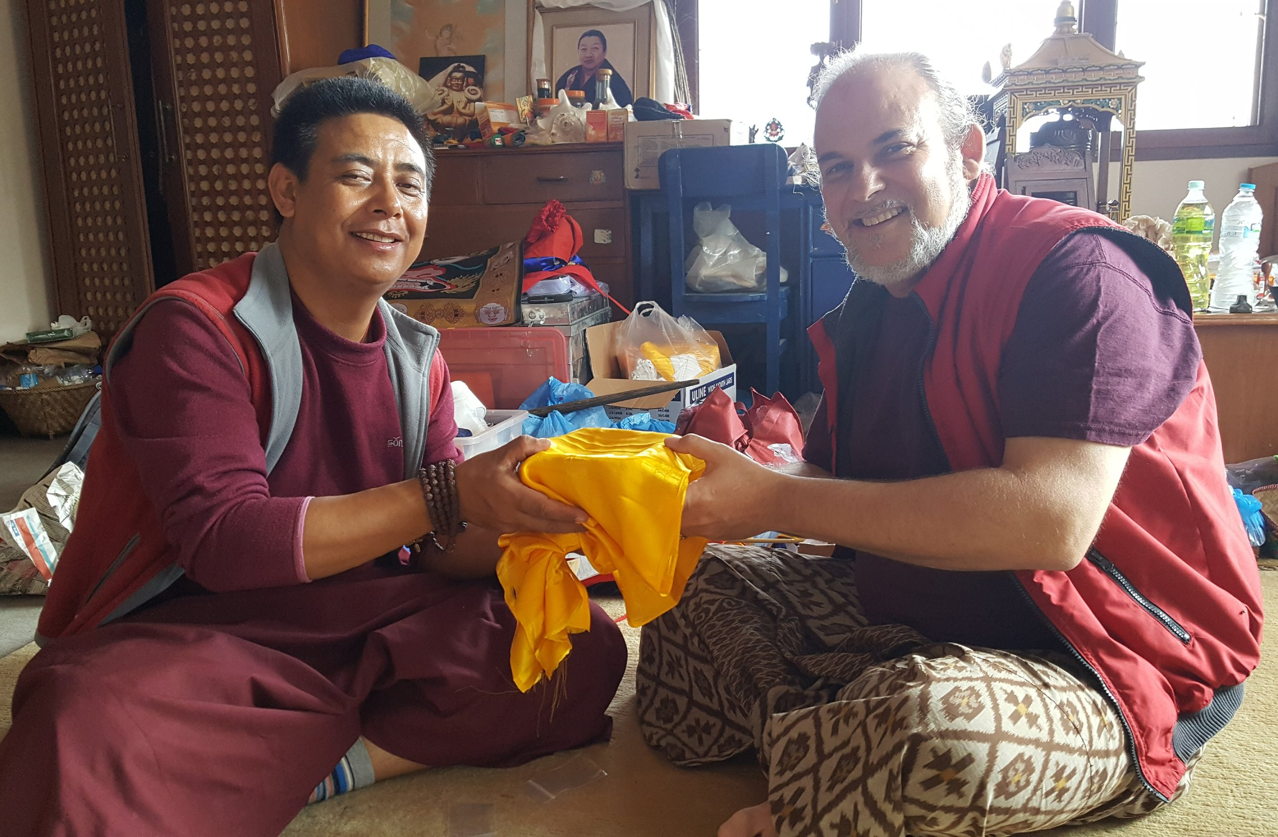 Lama Pema Thobchen offering relics for mendrup
