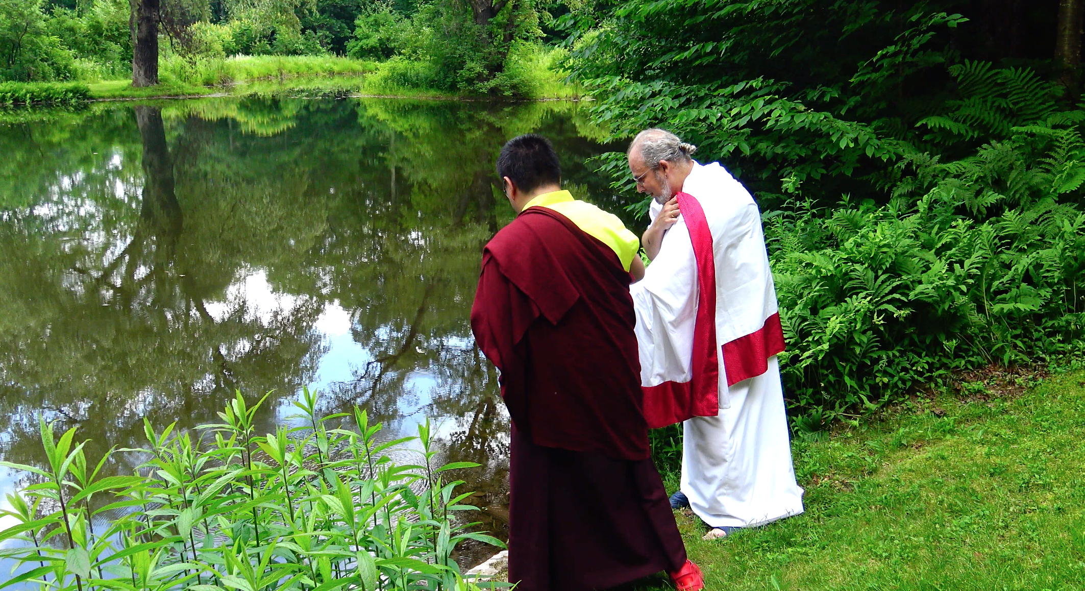 Rinpoche offering Mendrup to the pond dwellers