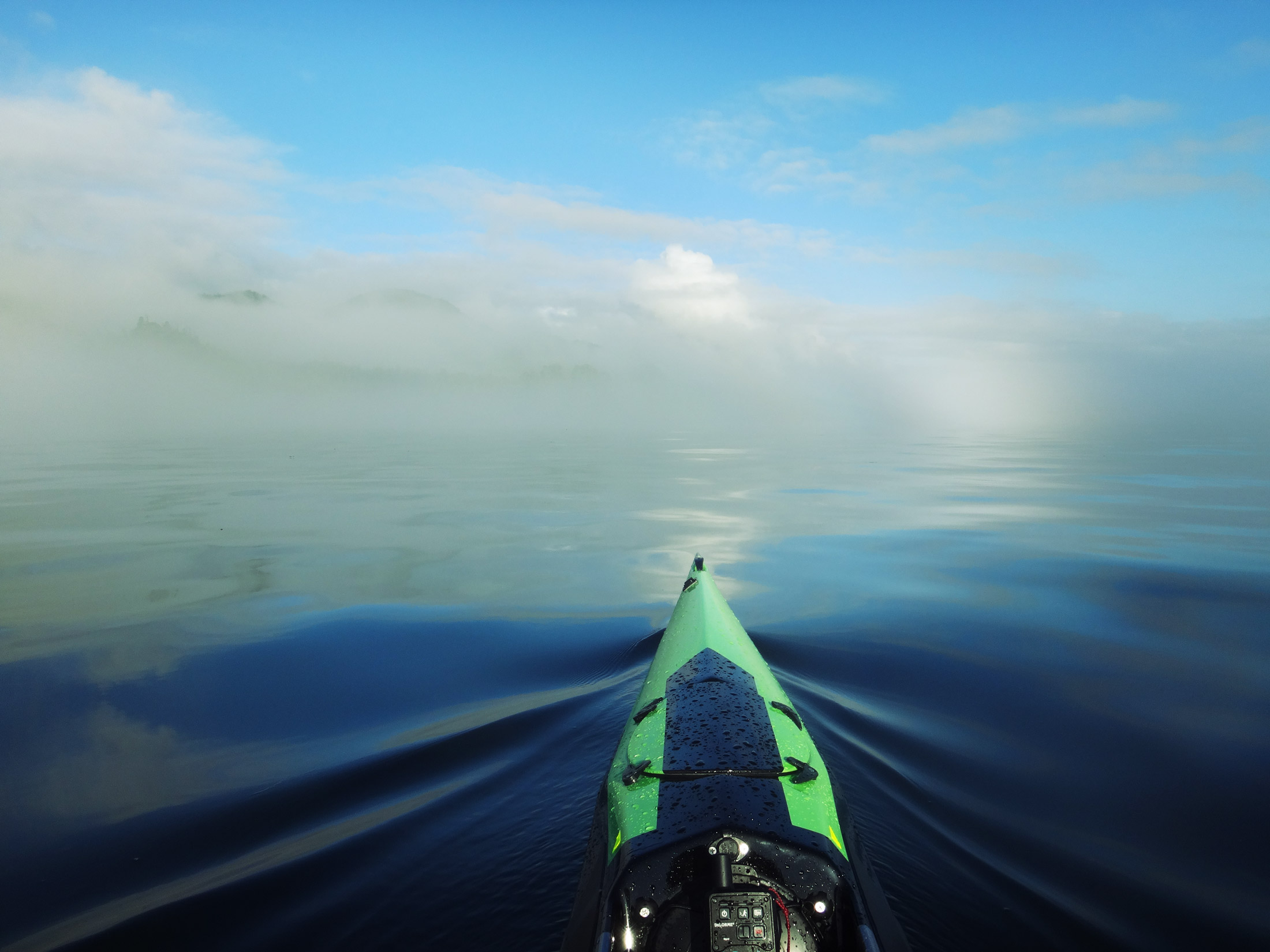 Glass smooth water and clearing fog in the Goletas Channel made for a dramatic start to my expedition.