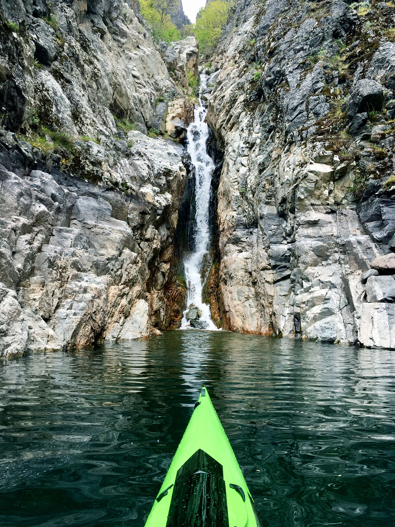 Another fantastic aspect of paddling by the shear cliffs and discovering some of the numerous hidden waterfalls that plunge hundreds of feet directly into the water below. In a kayak or SUP, one can get quite close to them.