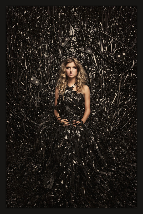 Ames beauty Maggie Doyle sits upon a throne constructed from VHS tape to be photographed by Des Moines Photographer McClanahan Studio. Image is a metaphor about the impact media has on our subconscious minds in American culture. Photo was chosen for the 2014 PPA General Collection.