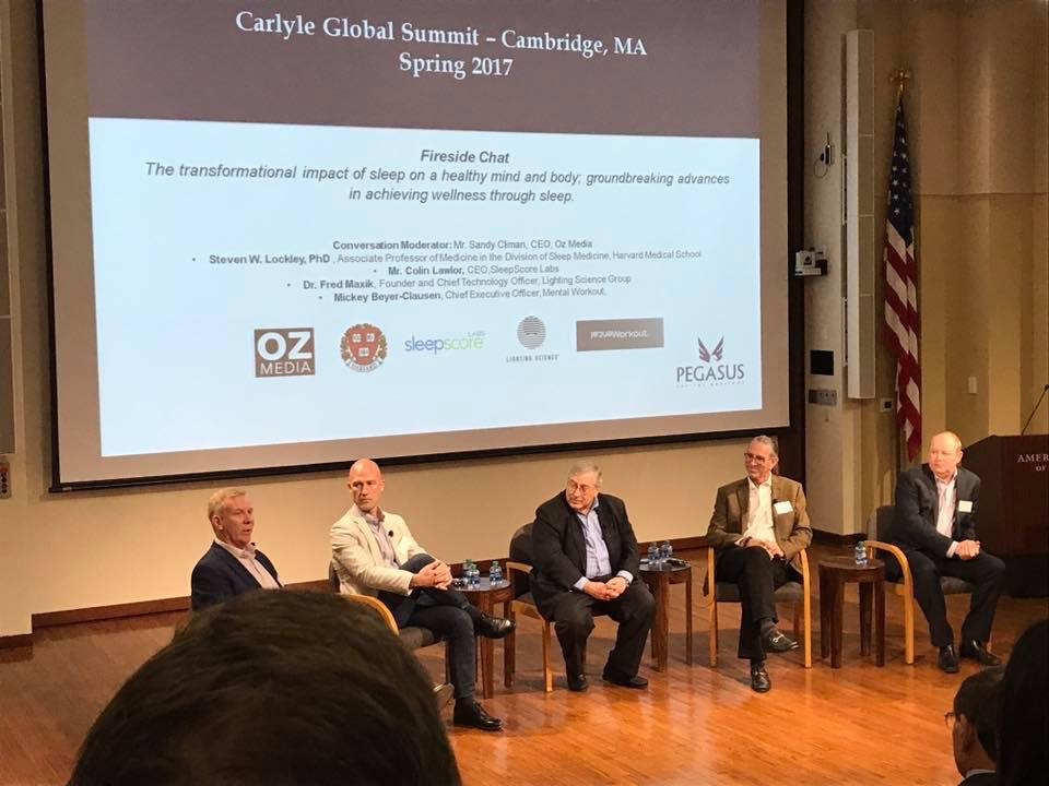 Mickey Beyer-Clausen speaking at the Carlyle Summit in Cambridge, Massachusetts