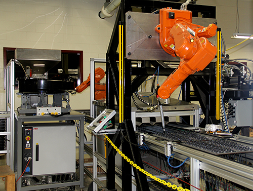 Robotic machine assembly cells