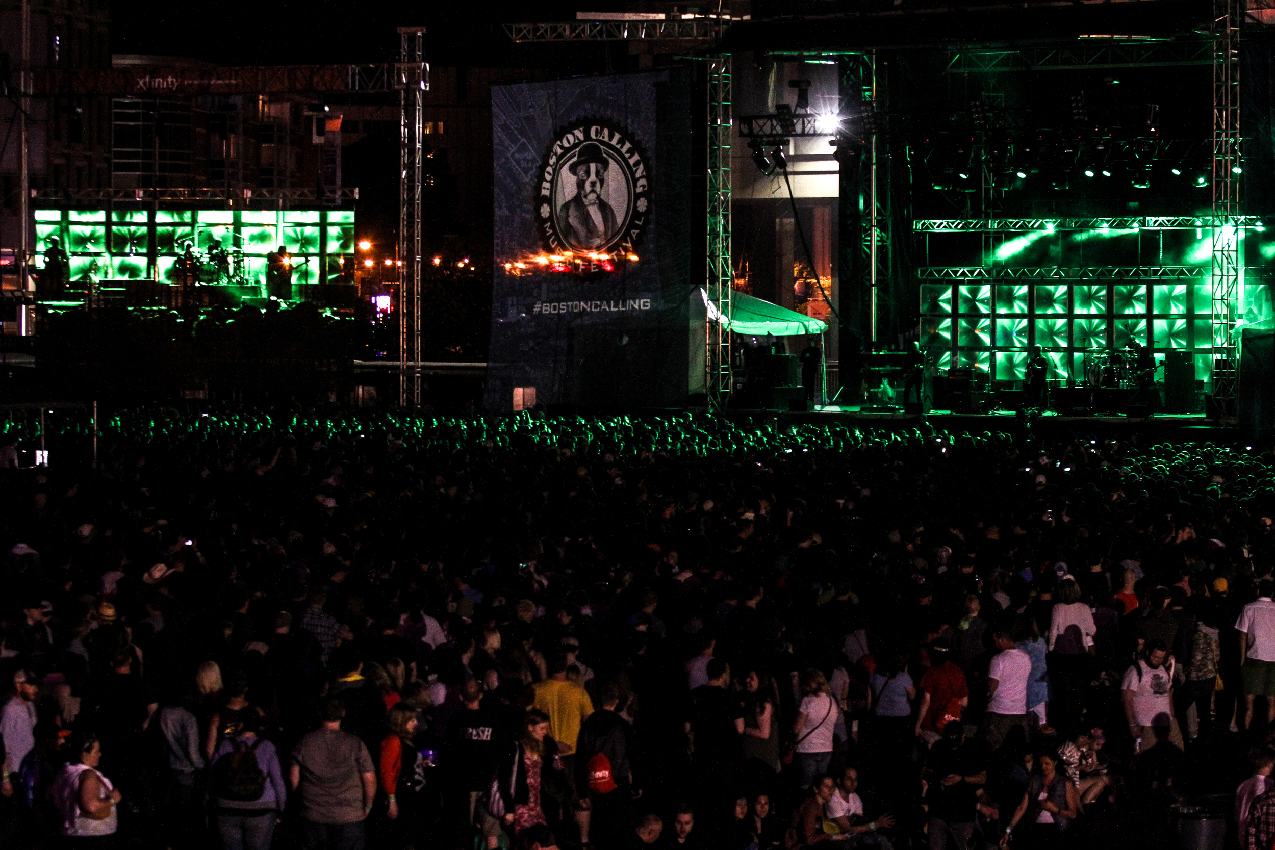 Hundreds of attendees listen to The Pixies' set, the last act of Boston Calling on May 24, 2015 in City Hall Plaza.